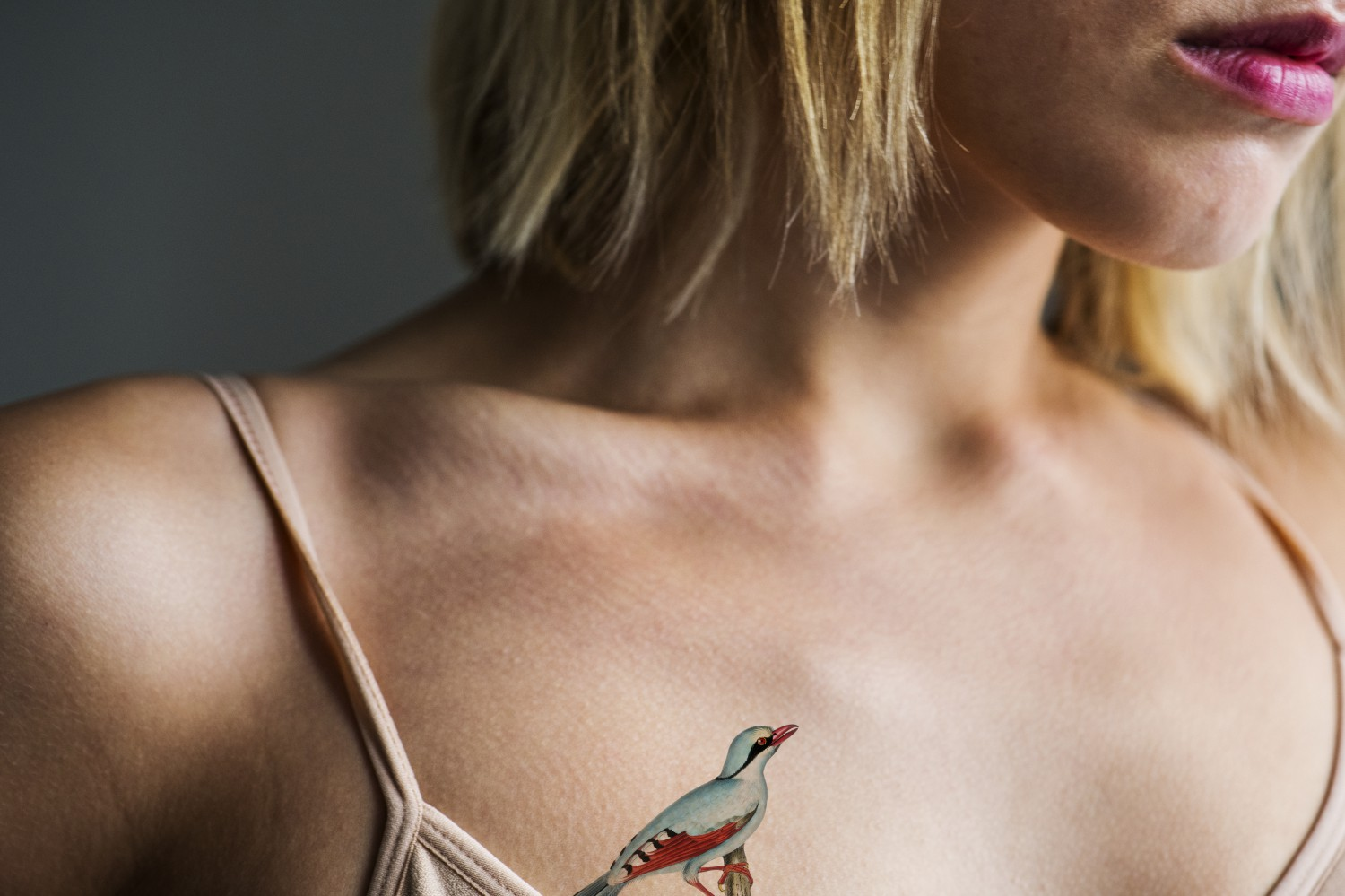 close up of tattoo on the chest of a woman pubdgn compressed